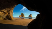 Collection\Msft\Landscapes: Looking-through-cave-opening-to-sea-shore